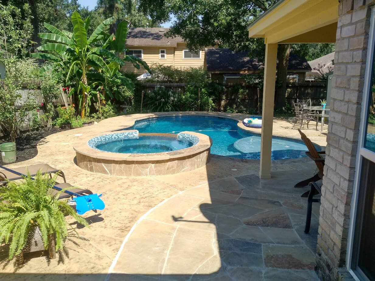 really nice swimming pool installed into small backyard