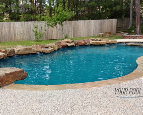 custom pool contractors Montgomery, TX 77316 free form rock waterfall